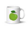 white mug with green apple vector image vector image
