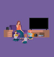 woman with kids in the livingroom reading books vector image vector image