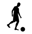 man kicks the ball silhouette soccer player vector image