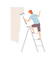 painter paints the wall with roller standing on a vector image vector image
