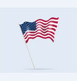usa flag on flagpole waving in wind vector image vector image