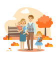 happy family walking together in autumn park vector image vector image