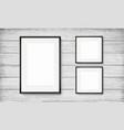 set of black frames on wooden background vector image