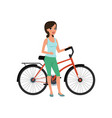 beautiful woman standing next to her bicycle vector image vector image