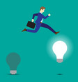 businessman jumping to bright light bulb vector image vector image