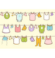 Cute hand drawn baby clothes vector image