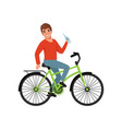young man riding bicycle and holding bottle of vector image vector image