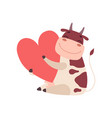 cute smiling cow sitting on floor with big red vector image vector image