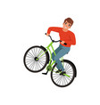 smiling male bicyclist riding a bike active vector image