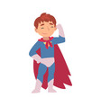 boy in a superhero costume shows muscles on his vector image vector image