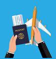 passenger jet boarding pass and passport in hand vector image vector image