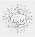 fist with sunburst vector image vector image