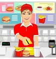 male fast food employee returning credit card vector image vector image