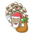 santa with gift enoki mushroom mascot cartoon vector image
