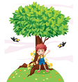 A young boy standing under a big tree with two vector image vector image