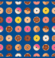doodle donuts pattern on blue background vector image vector image