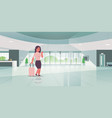 businesswoman with luggage modern reception area vector image