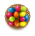 easter eggs with wicker basket vector image vector image