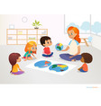 children sit around world map and redhead female vector image