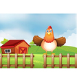 A hen above the fence with a wooden house at the vector image vector image