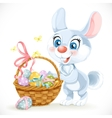 Cute Easter Bunny with a basket of eggs vector image vector image