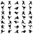 Black karate silhouettes vector image vector image