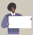 a young man holding blank paper vector image vector image