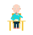 Elderly man eat at the table vector image