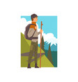 man hiking in mountains with backpack and staff vector image vector image