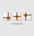 white gift boxes with golden ribbons and bows vector image