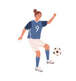 Female football player kicking ball foot young