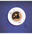 Cup of coffee on a jeans background vector image vector image