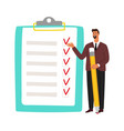 businessman and checklist man holding pencil vector image