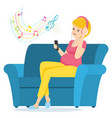 pregnant woman sits on a sofa and listens to music vector image vector image