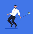 business man using selfie stick taking photo on vector image vector image
