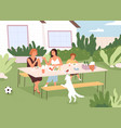 family sitting at table in backyard house