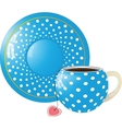 Blue with white dots Cup and saucer vector image