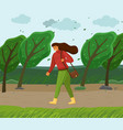 windy weather woman walking in park through vector image