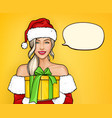 girl in christmas santa costume holding gift box vector image vector image