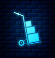 glowing neon hand truck and boxes icon isolated on vector image vector image