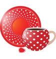 Red with white dots Cup and saucer vector image