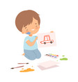 cute boy sitting on floor on his knees and vector image vector image