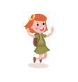joyful little girl scout character jumping with vector image