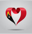 timor-leste flag heart-shaped ribbon vector image vector image