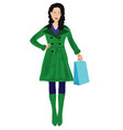 woman in green coat shopping vector image