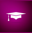 Graduation cap icon isolated on purple background