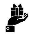 hand with gift icon black vector image vector image