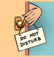 do not disturb woman hand hangs a sign on door vector image