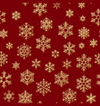 seamless pattern with golden snowflakes on red vector image vector image