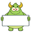 horned green monster holding a blank sign vector image